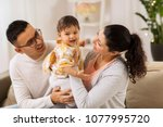family  parenthood and people... | Shutterstock . vector #1077995720