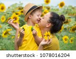 mom and son hug  laugh and play ... | Shutterstock . vector #1078016204