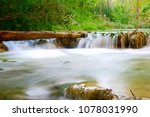 water flow along the creek at... | Shutterstock . vector #1078031990