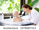 little child taking bubble bath ...   Shutterstock . vector #1078087313