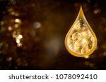 golden drop of collagen serum... | Shutterstock . vector #1078092410