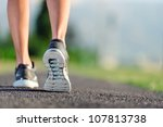 feet of an athlete running on a ... | Shutterstock . vector #107813738