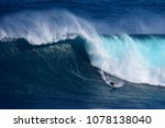 a surfer catches a massive wave ... | Shutterstock . vector #1078138040