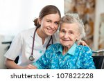 senior woman with her caregiver ... | Shutterstock . vector #107822228