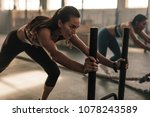 strong young female pushing the ... | Shutterstock . vector #1078243589