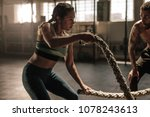 female exercising with battle... | Shutterstock . vector #1078243613