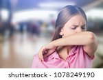 woman coughing into hand | Shutterstock . vector #1078249190