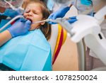 a little girl is curing a tooth ...   Shutterstock . vector #1078250024