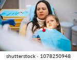 a little girl is curing a tooth ...   Shutterstock . vector #1078250948