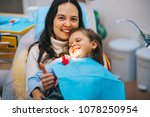 a little girl is curing a tooth ...   Shutterstock . vector #1078250954