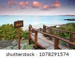 wooden boardwalk threw sand...   Shutterstock . vector #1078291574