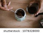 making coffee in a moka pot | Shutterstock . vector #1078328000