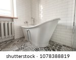 white bathroom on a tiled wall... | Shutterstock . vector #1078388819
