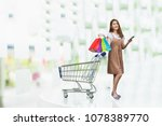 concept of woman shopping and... | Shutterstock . vector #1078389770