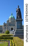 Small photo of VICTORIA, BC, CANADA, JUNE 23 2015 Queen Victoria statue in front the British Columbia Parliament Buildings are home to the Legislative Assembly of British Columbia.