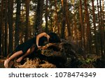 girl sad into the woods | Shutterstock . vector #1078474349