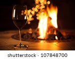 Fireside With A Glass Of Wine ...
