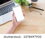 phone in hand on desk work top... | Shutterstock . vector #1078497920
