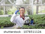 young pretty woman agronomist... | Shutterstock . vector #1078511126