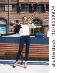 young brunette woman on street... | Shutterstock . vector #1078519874
