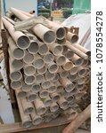 Small photo of Suzhou, Jiangsu / China - December 15 2013: Stack of small bore pipes at construction site for pipe boring