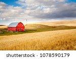 a red barn in the fall season... | Shutterstock . vector #1078590179