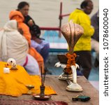 Small photo of Banaras, UP/ India- December 28, 2016: A serpent shaped brass lamp and other things for the auspicious Ganga aarti at Dashashwamedh ghat