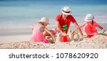 family making sand castle at... | Shutterstock . vector #1078620920