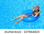 young woman with hat enjoying a ... | Shutterstock . vector #107866823