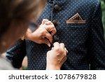 woman buttoning groom's suit | Shutterstock . vector #1078679828