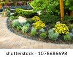 flowerbed in the yard in... | Shutterstock . vector #1078686698