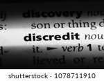 Small photo of discredit word in a dictionary. discredit concept