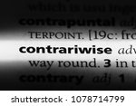 Small photo of contrariwise word in a dictionary. contrariwise concept