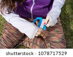 young girl spooling up her kite ... | Shutterstock . vector #1078717529