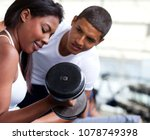 woman at the gym exercising... | Shutterstock . vector #1078749398