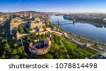 Small photo of Budapest, Hungary - Aerial panoramic skyline view of Buda Castle Royal Palace with Szechenyi Chain Bridge, St.Stephen's Basilica, Hungarian Parliament and Matthias Church at sunrise with blue sky