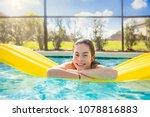 happy teenage girl floating in... | Shutterstock . vector #1078816883