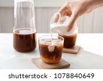 woman pouring milk into glass... | Shutterstock . vector #1078840649