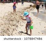 kids on a sea beach. | Shutterstock . vector #1078847486