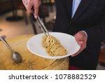 chef neatly plating spaghetti... | Shutterstock . vector #1078882529