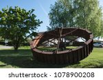 Small photo of Gex, Rhone Alps France - April 2018: The large vintage water wheel is now used as a landscape decor