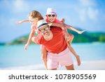 father and kids enjoying beach...   Shutterstock . vector #1078905569