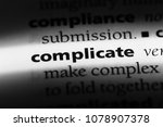 Small photo of complicate word in a dictionary. complicate concept