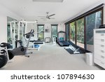 private gym in luxury home | Shutterstock . vector #107894630