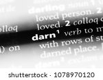 Small photo of darn word in a dictionary. darn concept