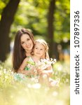 mother and daughter in the park | Shutterstock . vector #107897336