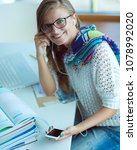 Small photo of Woman use of mobile phone in university. Student. University