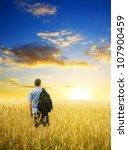 man in yellow wheat meadow.... | Shutterstock . vector #107900459
