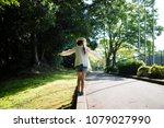 little girl walking curb | Shutterstock . vector #1079027990