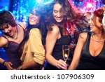 Stock photo cheerful girls living it up on the dance floor 107906309